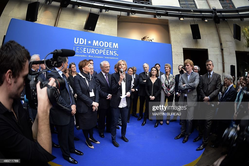 Candidates of the French centrist parties union for the upcoming European elections, UDI-MODEM, surround the head of the list for Ile-de-France (Paris region), French center-right Modem party Vice President Marielle de Sarnez (C) during their presentation on April 7, 2014 in Paris. CL, Jean Arthuis, CR at background, Chantal Jouanno, R, Jean-Christophe Lagarde, mayor of Drancy, a Paris suburb.