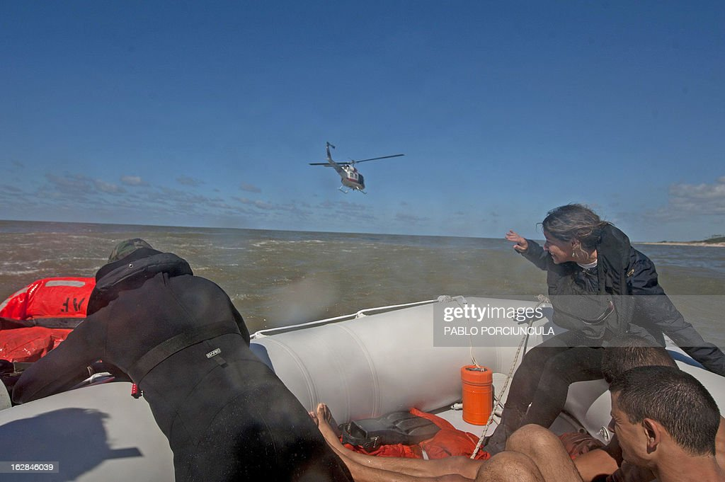 Candidates to the Air Force Academy and members of the Uruguayan Air Force Operations, Training and Rescue Unit, take part in a drill at a beach of Salinas, near Montevideo, Uruguay, on February 27, 2013.AFP PHOTO/Pablo PORCIUNCULA