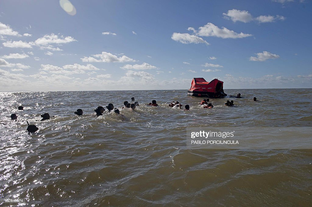 Candidates to the Air Force Academy swim during a drill with members of the Uruguayan Air Force Operations, Training and Rescue Unit, at Salinas' coast, near Montevideo, Uruguay, on February 27, 2013.AFP PHOTO/Pablo PORCIUNCULA