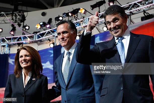 Candidates US Rep Michele Bachmann Mitt Romney and Texas Gov Rick Perry take the stage before the start of the Ronald Reagan Centennial GOP...