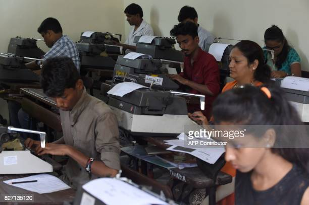 Candidates use typewriters during the last official typing exam conducted by the state government in Mumbai on August 7 2017 Typewriters have largely...