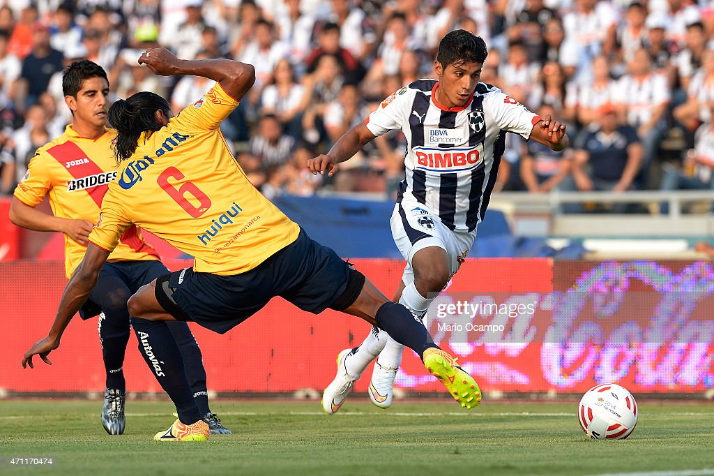 Candido Ramirez of Monterrey fights for the ball with <a gi-track='captionPersonalityLinkClicked' href=/galleries/search?phrase=Joel+Huiqui&family=editorial&specificpeople=875917 ng-click='$event.stopPropagation()'>Joel Huiqui</a> of Morelia during a match between Monterrey and Morelia as part of 15th round of Clausura 2015 Liga MX at Tecnologico Stadium, on April 25, 2015 in Monterrey, Mexico.