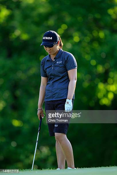 Candie Kung of Taiwan chips on the 16th hole during the championship match against Azahara Munoz of Spain at the Sybase Match Play Championship at...
