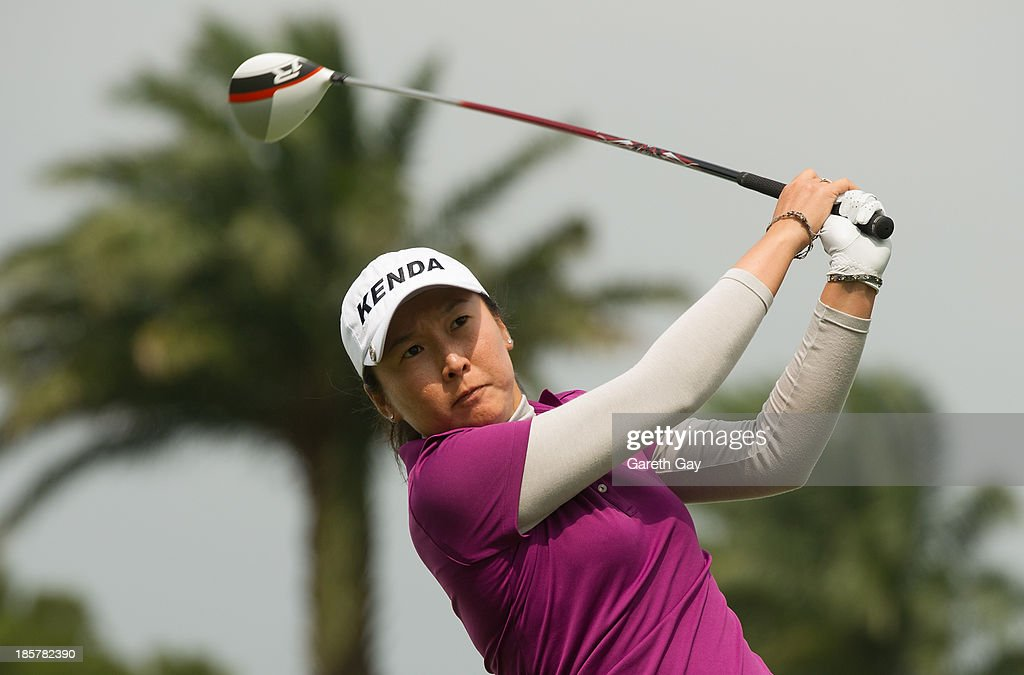 <a gi-track='captionPersonalityLinkClicked' href=/galleries/search?phrase=Candie+Kung&family=editorial&specificpeople=221492 ng-click='$event.stopPropagation()'>Candie Kung</a> of Taiwan tees off on the ninth hole during day two of the Sunrise LPGA Taiwan Championship on October 25, 2013 in Taoyuan, Taiwan.