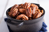 Candied Pecan Halves in a Cast Iron Serving Dish