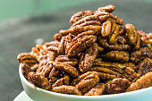 Bowl of candied pecans piled high