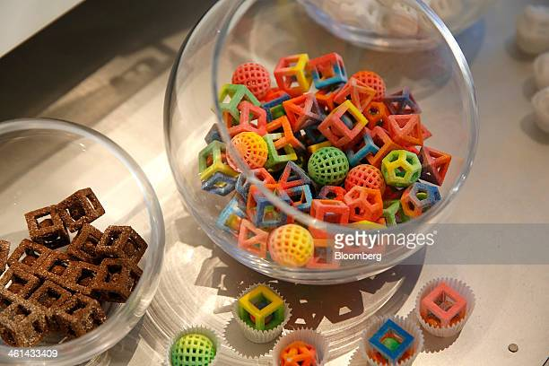 Candies made by the 3D Systems Chef Jet printer sit on display during the 2014 Consumer Electronics Show in Las Vegas Nevada US on Wednesday Jan 8...