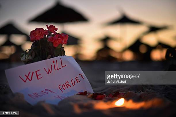 A candle and flowers are left at Marhaba beach near to where 38 people were killed on Friday in a terrorist attack on June 28 2015 in Souuse Tunisia...