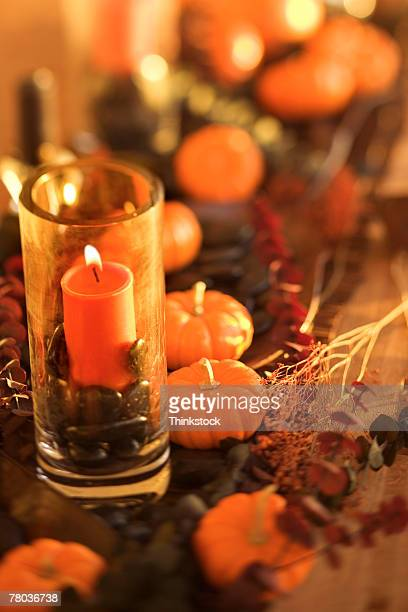 Candle and miniature pumpkins