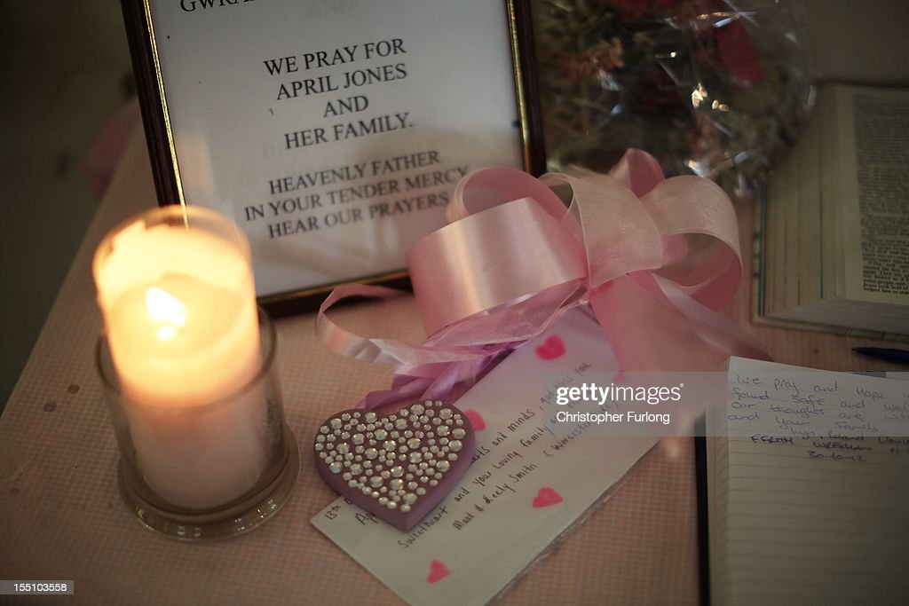 A candle and other momentos are placed alongside a book of condolences on a table at Saint Peter's Curch on November 1, 2012 in Machynlleth, Wales. Coral and Paul Jones, the parents of missing April, have thanked the public for their 'kind words and sentiments' which have provided support in the month that has passed since her abduction.