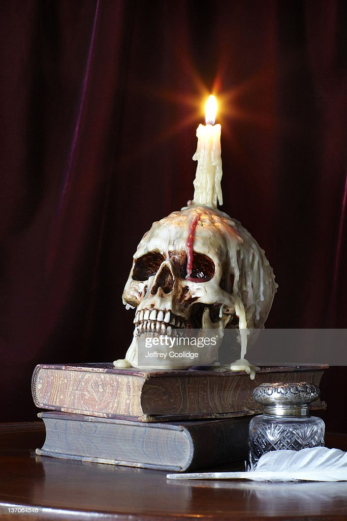 Candle and Skull on Books : Stock Photo