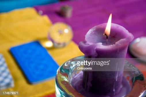 Candle and tarot cards