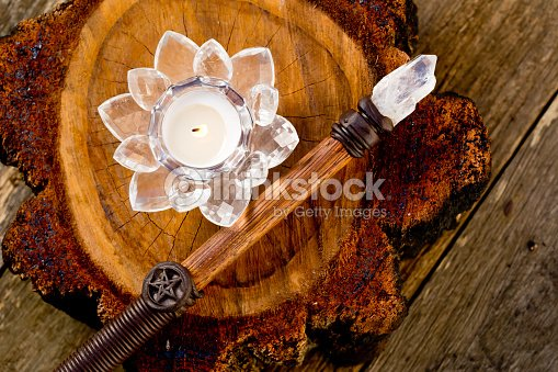 Candle Burning In Crystal Lotus Flower Holder Sitting On Cross