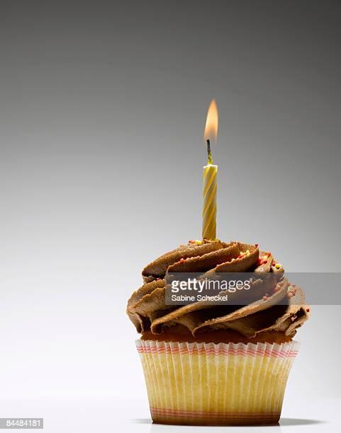 candle burning on cupcake