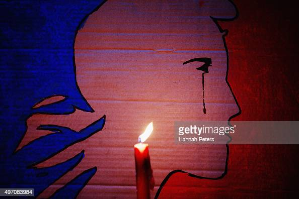 A candle burns during a vigil in Aotea Square to remember victims of the Paris attacks on November 14 2015 in Auckland New Zealand According to...