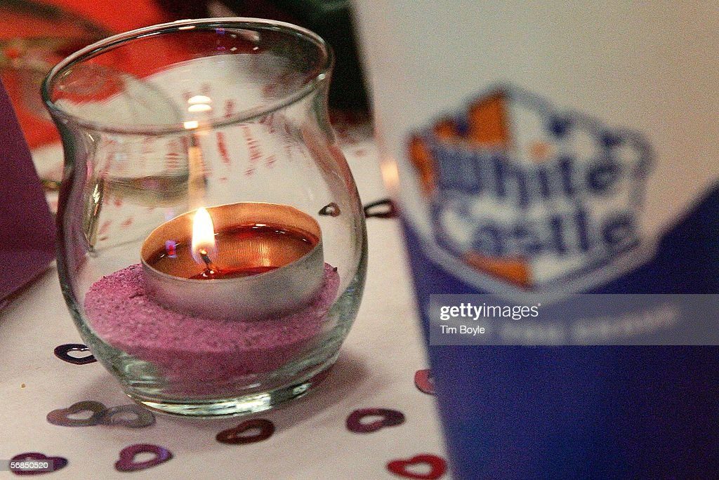 A candle is seen next to a White Castle soft-drink cup during a Valentine's Day dinner at a White Castle restaurant February 14, 2006 in Des Plaines, Illinois. For Valentine's Day, numerous White Castle restaurants nationwide took dinner reservations offering candlelit dining with individual servers as well as hostess seating.