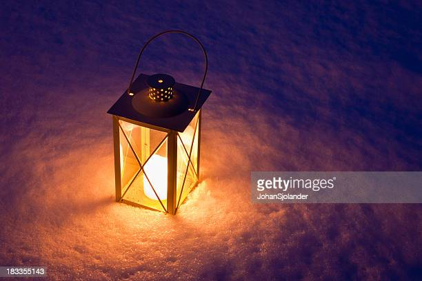 Candle Lantern In Snow at Twilight