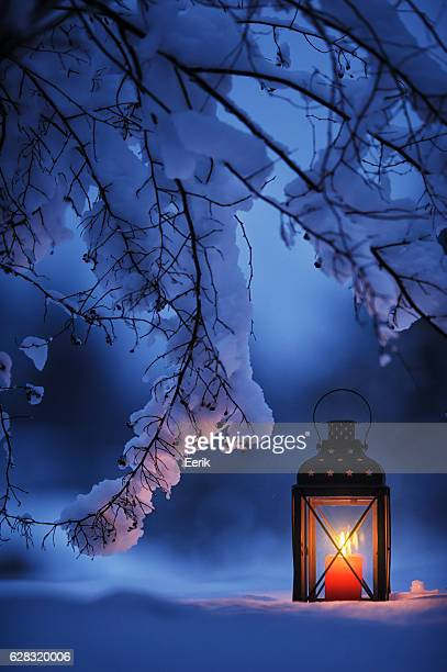 Candle lantern in the snow