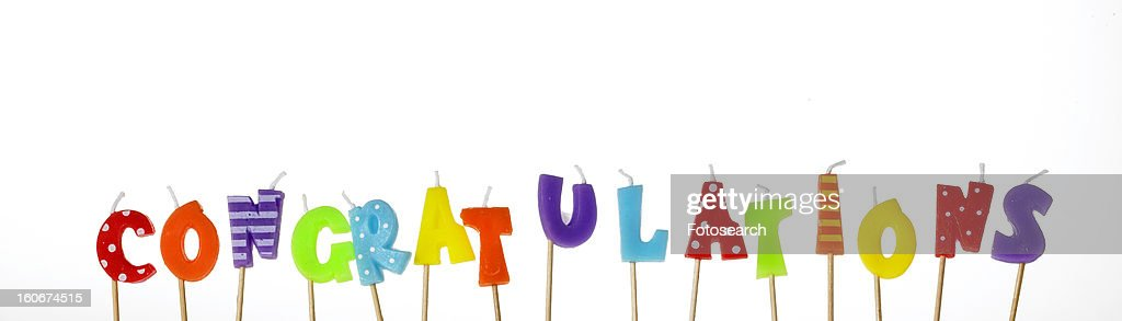 Candle letters spelling out congratulations
