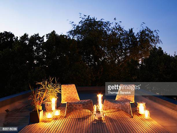 Candle lit rooftop deck at dusk