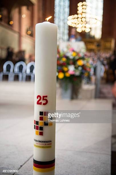 A candle pictured at a church service at 'Kaiserdom' to celebrate the 25th anniversary of German reunification on October 3 2015 in Frankfurt Germany...