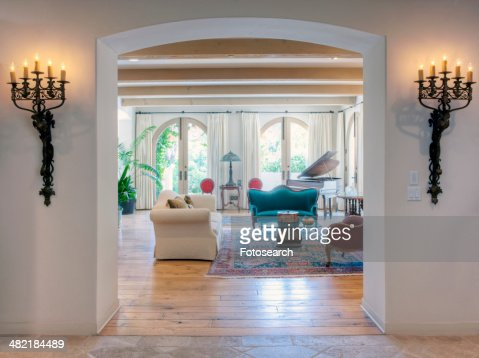 Candle Sconces On Wall At Entrance Of Living Room Stock Photo