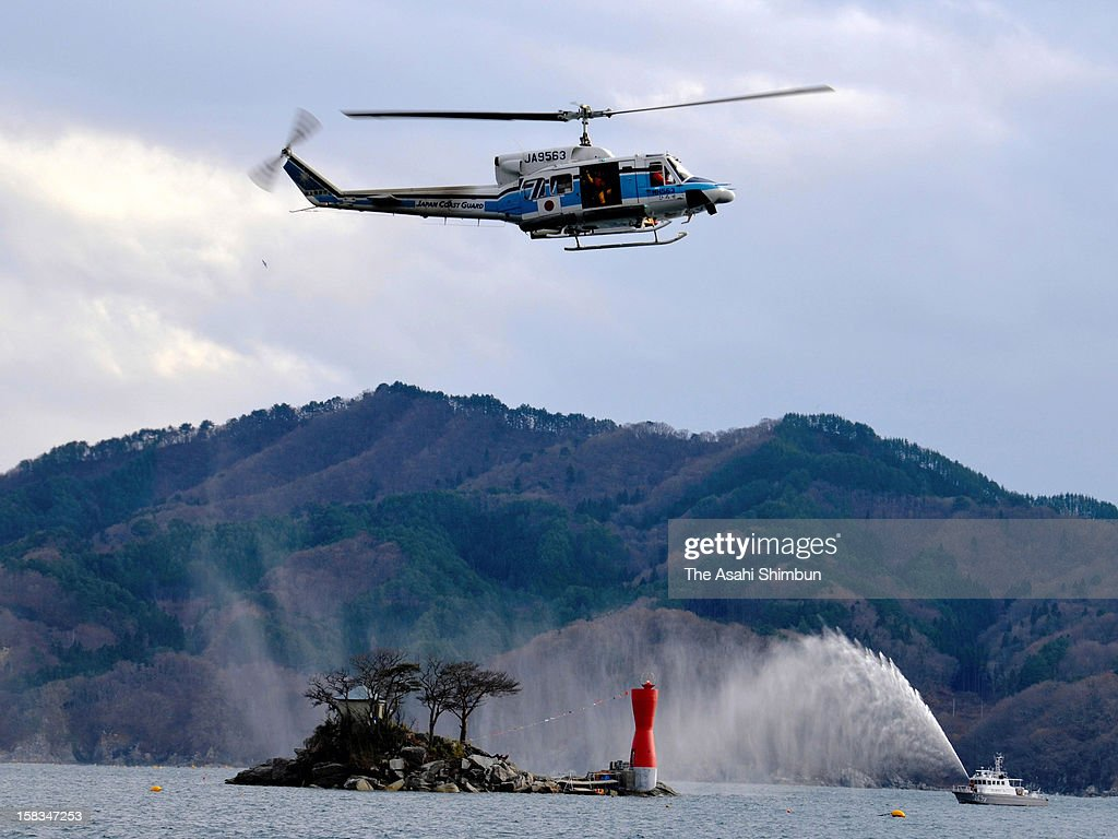 A candle shaped new lighthouse is seen at Horai Island, said to be the model of the famous television puppet drama 'Hyokkori Hyotan Jima' on December 13, 2012 in Otsuchi, Iwate, Japan. the lighthouse of the island was destroyed by the tsunami triggered by the Great East Japan Earthquake last year.