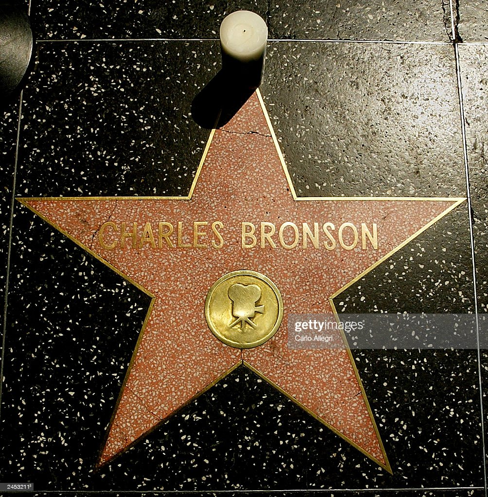 A candle stands at the star of actor Charles Bronson on the Hollywood Walk of Fame September 1, 2003 in Hollywood, California. Bronson died of pneumonia at the age of 81 August 30, 2003 in Los Angeles, California.