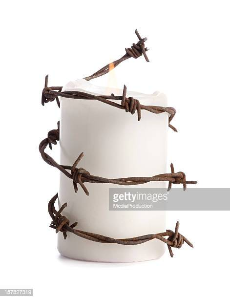 candle with barbed wire