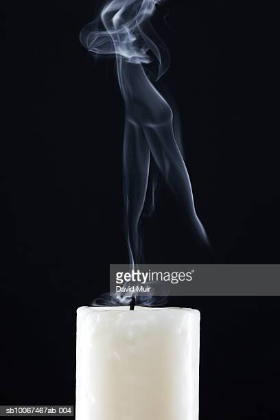 Candle with smoke in shape of women, close-up