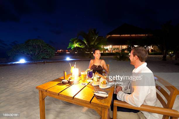 candlelight dinner beach couple