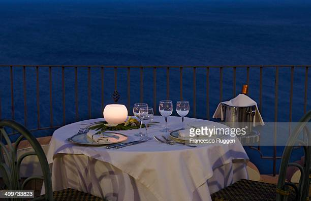 Candlelight dinner table overlooking the sea