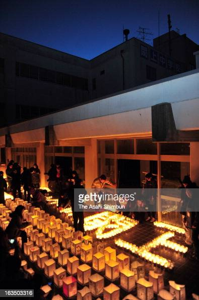 Candlelit lanterns are placed to commemorate the victims at former Yuriage Juniro High School on March 10 2013 in Natori Miyagi Japan On March 11...