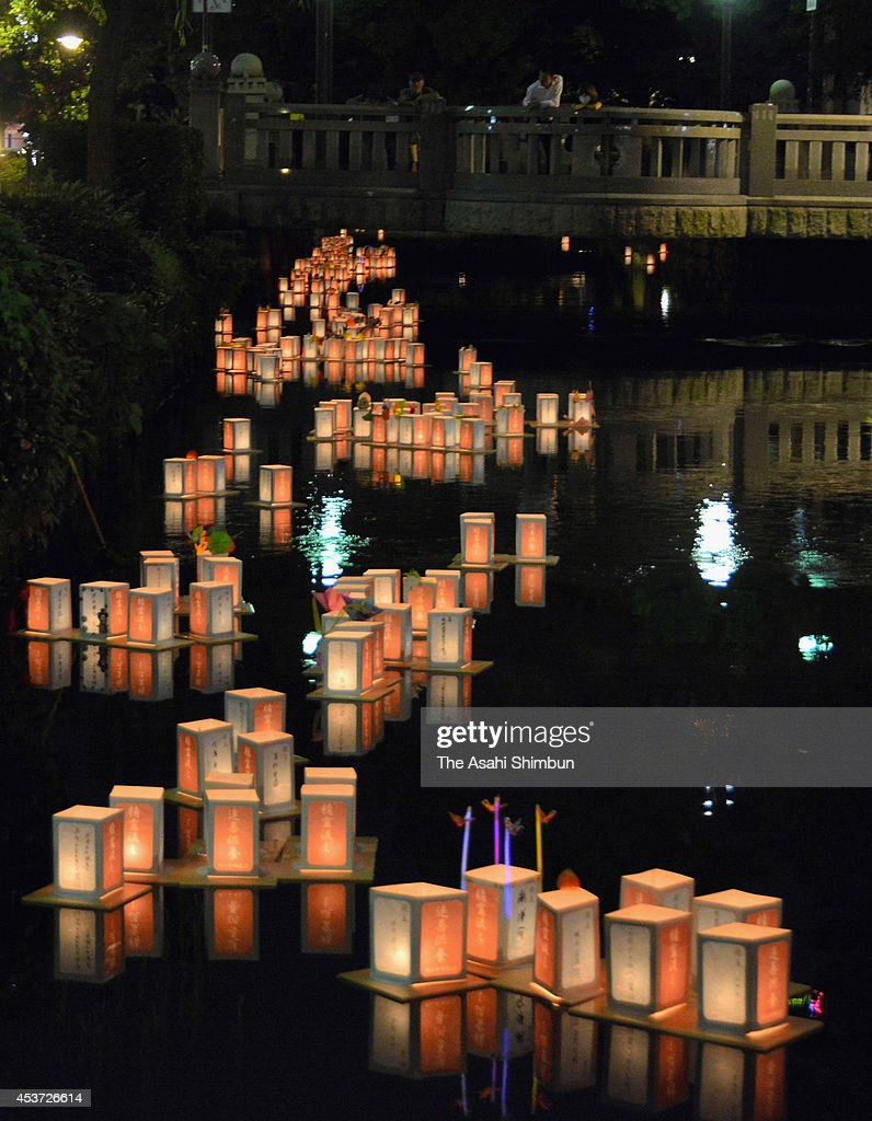 Candlelit paper lanterns are afloat on the Nishigawa River to commemorate ancestors' souls on August 16, 2014 in Okayama, Japan. Japan is in a holiday week of the 'Bon', or 'Obon', a Japanese custom and season to honor the spirits of ancestors in mid-August.