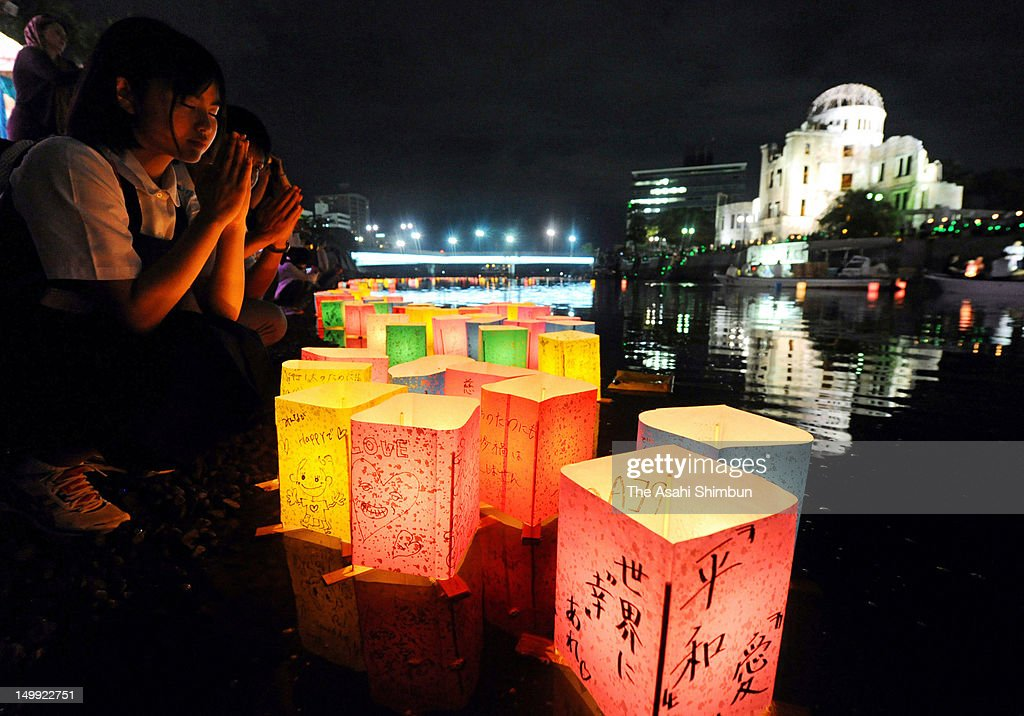 Candle-lit paper lanterns float on the Motoyasu River in front of the Hiroshima Peace Memorial, commonly called the Atomic Bomb Dome, at the Hiroshima Peace Memorial Park on August 6, 2012 in Hiroshima, Japan. Hiroshima marks the 67th anniversary of its atomic bombing under the shadow of the Fukushima nuclear disaster and by issuing a plea for complete nuclear disarmament.