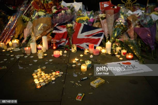 Candles and floral tributes are seen following an evening vigil outside the Town Hall on May 23 2017 in Manchester England An explosion occurred at...