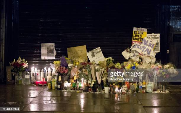 Candles and floral tributes laid outside the Yours Locally shop this evening where Rashan Charles was arrested by police last week in London England...