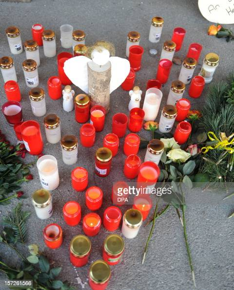 Candles and flowers are laid down in front of a workshop for disabled people in Titisee Neustadt southern Germany on December 1 2012 An oecumenical...