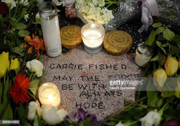 Candles and flowers are placed on actress Carrie Fisher's makeshift star on The Hollywood Walk of Fame on December 29 2016 in Hollywood California