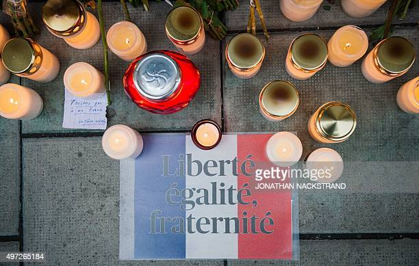 Candles and flowers are placed outside the French embassy in Stockholm on November 15 two days after the deadly attacks in ParisAFP PHOTO / JONATHAN...