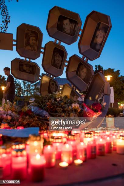 Candles and flowers are seen at a memorial to commemorate the victims of the shooting spree that one year ago left ten people dead including the...
