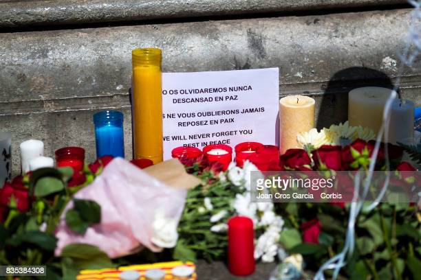 Candles and flowers offered in the street the day after the terrorist attack on August 18 2017 in Barcelona Spain