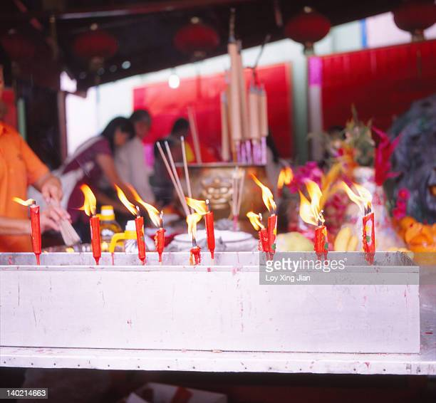 Candles and joss sticks at Chinese temple