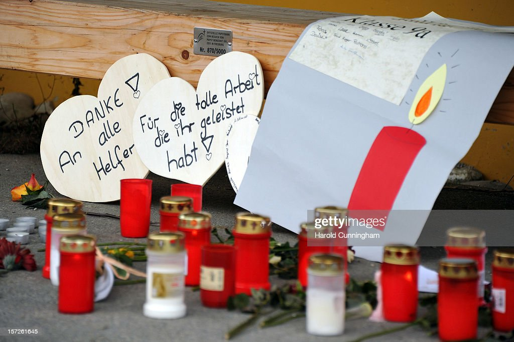 Candles and messages rest on the ground outside the Caritas center following a deadly fire that killed 14 people at the employment facility for handicapped, on December 1, 2012 in Titisee-Neustadt, Germany. The fire was reportedly caused by an explosion at the facility, where approximately 120 people with disabilities are employed in light manufacturing.