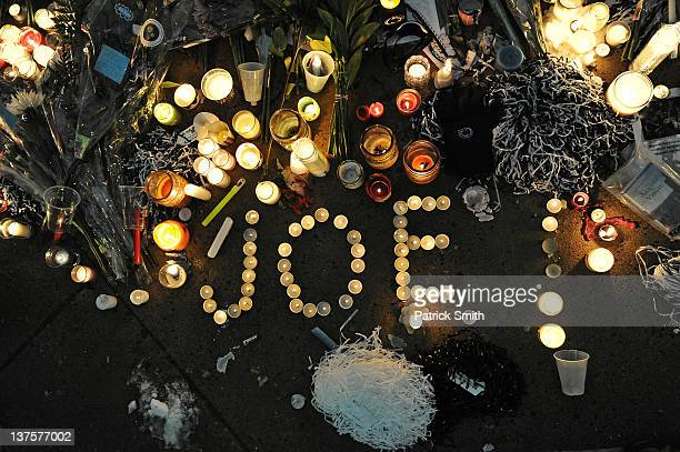 Candles and other memorabilia decorate the base of the statue of Joe Paterno the former Penn State football coach who died earlier in the morning...