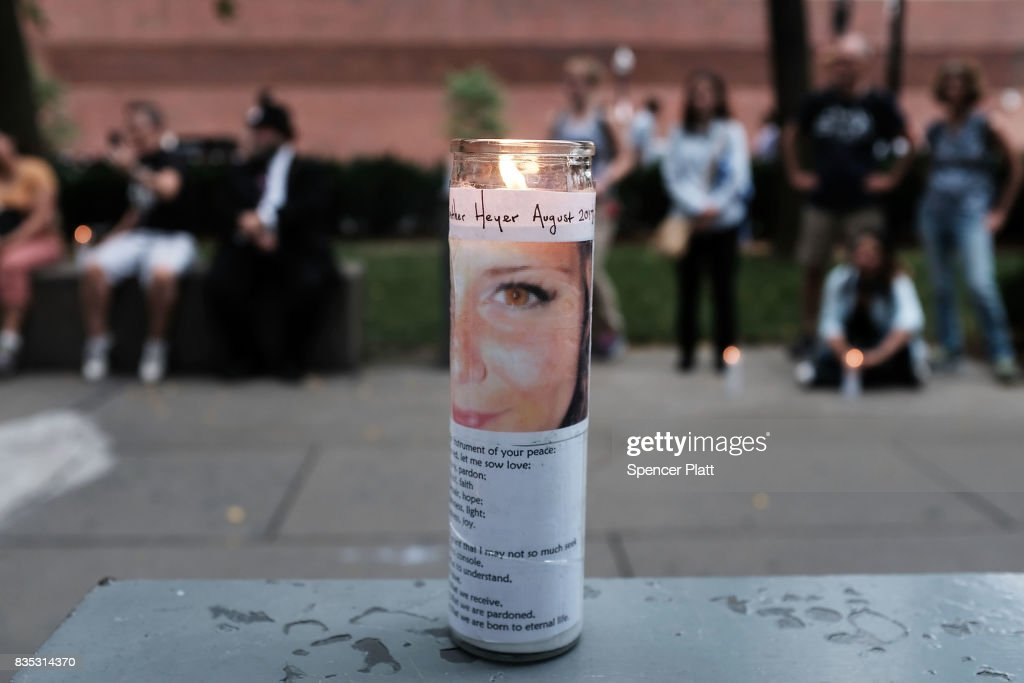 Candles are adorned with a picture of Heather Heyer at a vigil and march at the New England Holocaust Memorial to denounce hate groups before a controversial rally tomorrow on August 18, 2017 in Boston, Massachusetts. Heyer was killed last Saturday when a car rammed into a crowd of counter-protesters at a white nationalist rally in Charlottesville, Virginia. A free speech rally planned on Saturday on Boston Common has sparked fears of possible violence only a week after racially charged protests in Charlottesville, Virginia, turned deadly. Thousands of counter protesters are expected to attend the event which police vow to keep peaceful.