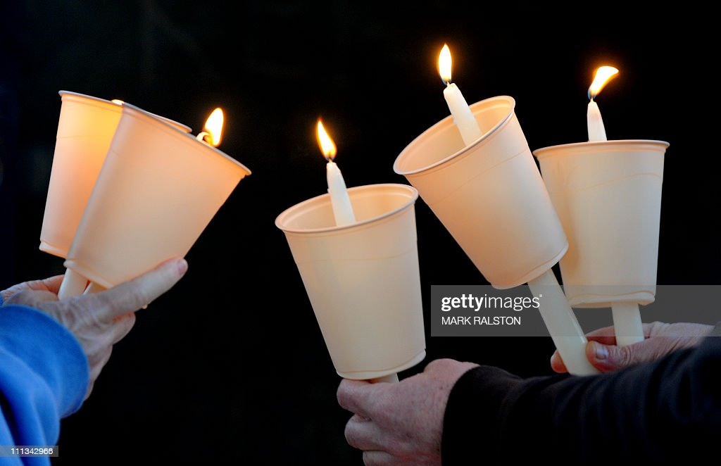 Candles are lit by antinuclear demonstrators as they hold a candlelight vigil to protest against nuclear power outside the Federal Building in Los...
