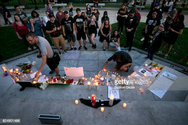 Candles are lit during a fancreated memorial for the late Chester Bennington the lead singer of the popular punk band Linkin Park at the Boston...