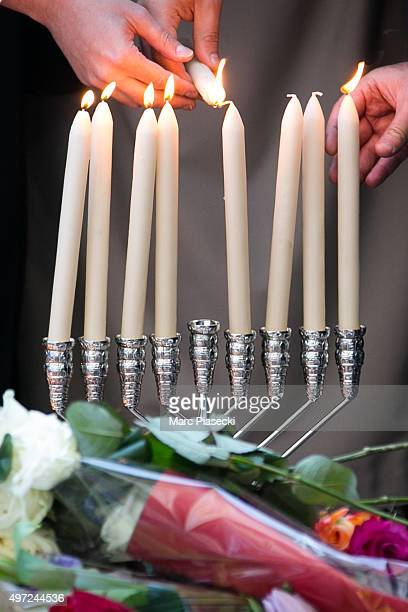 Candles are lit on a menorah near the 'Bataclan' theatre as France observes three days of national mourning on November 15 2015 in Paris France As...