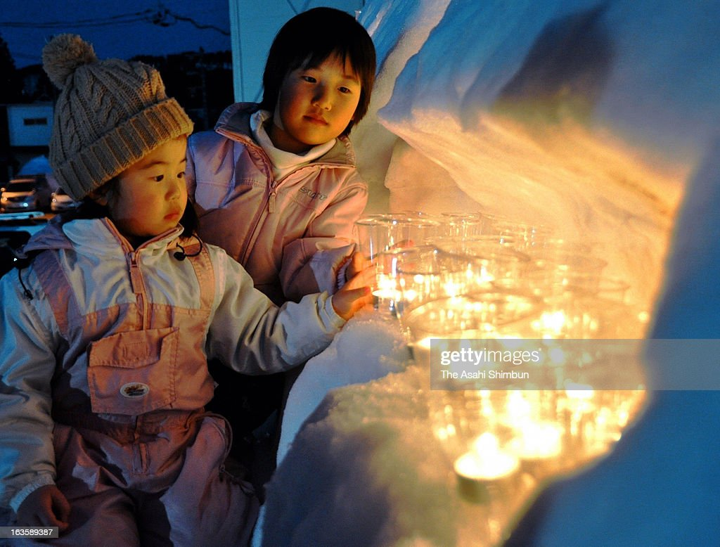 Candles are lit on the snow shelf to commemorate the second anniversary of Magnitude 6.7 strong earthquake on March 12, 2013 in Sakae, Nagano, Japan. The earthquake, hit Northern Nagano a day after the Great East Japan Earthquake, destroyed 202 houses.